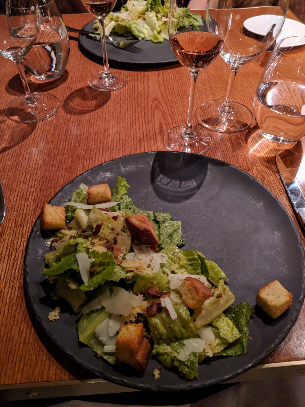Caesar Salad on a slate plate to start