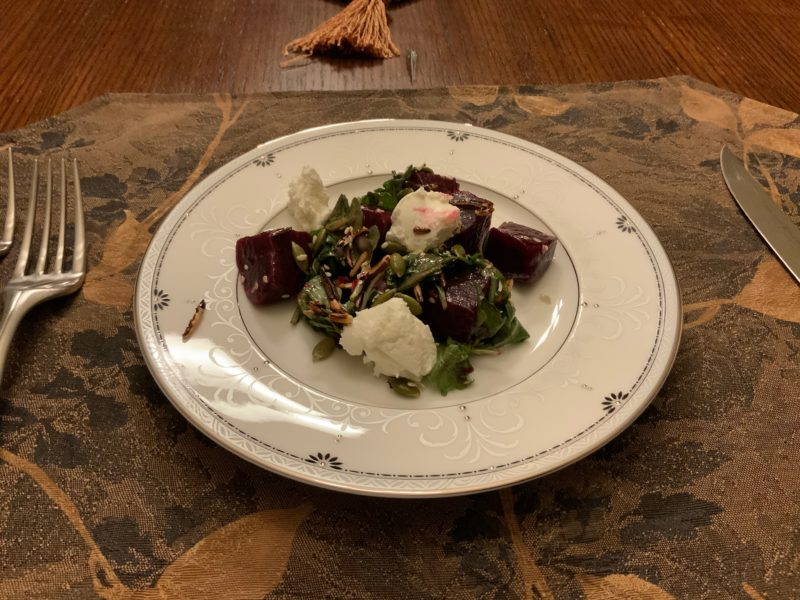 Peasant Beet Salad with beets, puffed wild rice, seeds, caramelized honey vinaigrette and goat mousse
